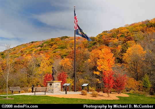 CCC Statue Monument with Fall Foliage Color Picture